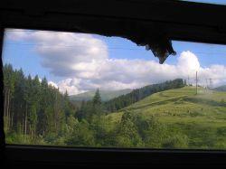 повернення додому, крізь вікно вагона - гори па-па